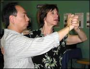 dance teacher instructing student